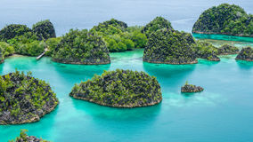 Painemo Island, Blue Lagoon, Raja Ampat, West Papua, Indonesia. Painemo Island, Blue Lagoon, Raja Ampat, West Papua Indonesia Royalty Free Stock Photography