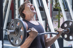 Painful arm workout Stock Images