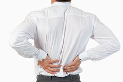 Painful back of a businessman. Against a white background stock images
