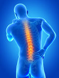 Painful back. A man having acute pain in the back Royalty Free Stock Images