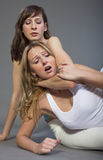 Painful choke hold Stock Photo