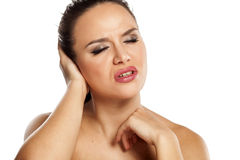 Painful ear. Young beautiful woman has pain in the ear Royalty Free Stock Photography