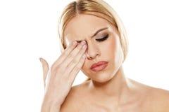 Painful eye. Beautiful young woman has pain in the eye Stock Photos