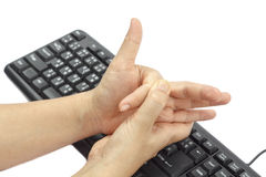 Painful finger due to prolonged use of keyboard. And mouse Royalty Free Stock Photos