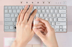 Painful finger while prolonged use of computer keyboard Royalty Free Stock Photos