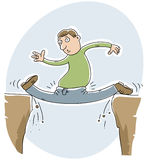 Painful Gap Splits. A cartoon man gets trapped doing the splits in a gap between tow rock cliffs Stock Photo