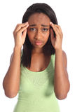 Painful headache for african american teen girl. Painful headache for young african american girl, holding her hands to temples with hurt showing on her face Royalty Free Stock Photos