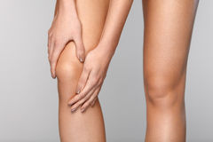 Painful Knee. Closeup Of Woman Feeling Pain In Knees. Royalty Free Stock Image