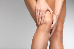 Painful Knee. Closeup Of Woman Feeling Pain In Knees. Painful Knee. Closeup Of Beautiful Woman Feeling Pain In Knee, Having Health Issue, Suffering From Joint Royalty Free Stock Photos