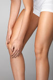 Painful Knee. Closeup Of Woman Feeling Pain In Knees. Stock Photo