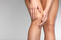Painful Knee. Closeup Of Woman Feeling Pain In Knees. Painful Knee. Closeup Of Beautiful Woman Feeling Pain In Knee, Having Health Issue, Suffering From Joint Stock Image