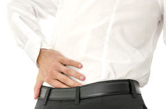 Painful lower back. Detail of man holding his painful lower back Royalty Free Stock Images