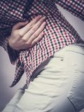 Woman feeling stomach cramps holding her belly Royalty Free Stock Images