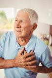 Painful senior man with pain on hea Royalty Free Stock Photos