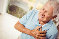 Painful senior man with pain on heart Royalty Free Stock Image