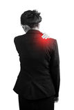 Painful shoulder in a businesswoman isolated on white background. Clipping path on white background. Painful shoulder in a businesswoman isolated on white royalty free stock photos