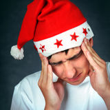 Painful Teenager in Santa Hat Royalty Free Stock Image