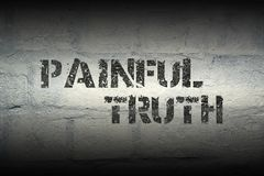 Painful truth gr. Painful truth stencil print on the grunge white brick wall stock images