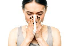 Painful woman with runny nose, snot or flu Stock Image
