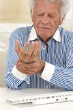 Painful wrist on elderly man Royalty Free Stock Photo