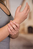 Painful Wrist In A Woman. Painful Wrist In a bautiful young woman royalty free stock photos