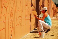 Paining a mural along a highway Royalty Free Stock Image