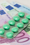 Painkiller tablets euro banknotes Stock Photos