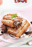 Pains au chocolat. Sprinkled with chopped nuts Royalty Free Stock Photography