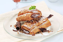 Pains au chocolat. Sprinkled with chopped nuts Stock Photos
