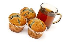 Pains et thé de myrtille Photos stock