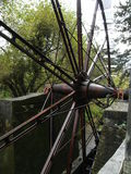 Painshill Metal water wheel, very large from England Stock Photo