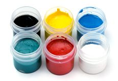 Paint. Color paints in bottles against white background Royalty Free Stock Photo