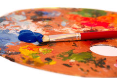 Paint. Brush with blue oil  on a classical palette Royalty Free Stock Photography