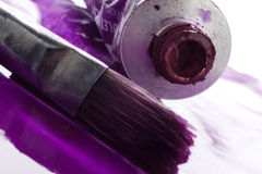 Paint. Tube and the brush - closeup Stock Photos