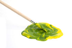 Paint. Green and yellow gouache with brush Royalty Free Stock Photos