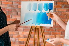 Paint art class teacher watercolor technique learn. Painting art classes teacher. watercolor techniques mastering. explanation communication and learning concept stock photography