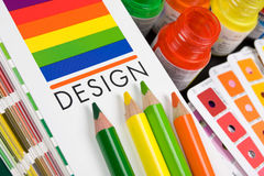 Paint in banks and pencils. Color pencils and paint in banks Stock Image