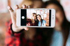 Paint blog artist photo workshop selfie leisure. Art painting blog. creative leisure. artist and her student take selfie in a workshop to share on the internet royalty free stock photos