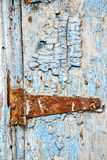 Paint in the blue wood door and morocco knocker Royalty Free Stock Image