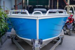 Paint the boat in blue and white.2 stock image