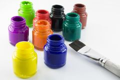 Paint bottles and brush Stock Image