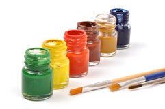 Paint bottles & brushes Stock Photography