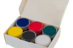 Paint, box, bright colors. Blue, red, green, yellow, white, black paint to draw in a box on a white background Royalty Free Stock Photography