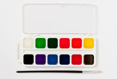 Paint box and brush Royalty Free Stock Photography
