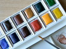 Paint box2. Watercolor set w/ paintbrush Stock Photography