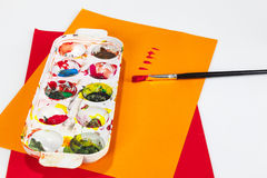 Paint boxes with brushes Royalty Free Stock Photo