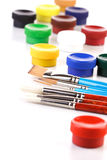 Paint boxes and brushes on white background Stock Photos