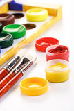 Paint boxes and brushes on white background Royalty Free Stock Photos