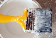 Paint brush. And gallon of paint Stock Photography