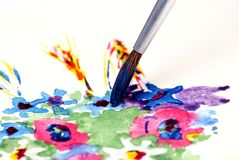 Paint brush. Flower painting picture, watercolors.Close-up Stock Image